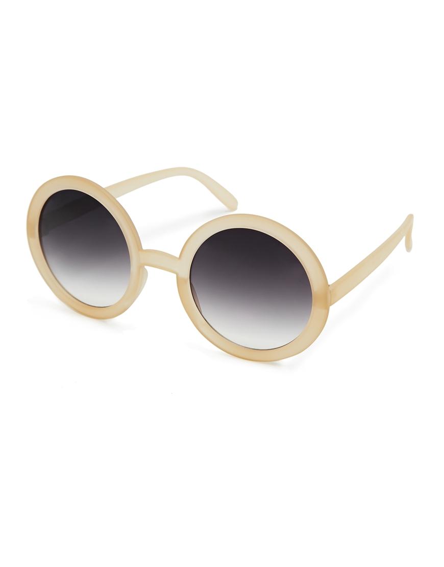 Gafas de sol redondas en color nude , tendencias gafas